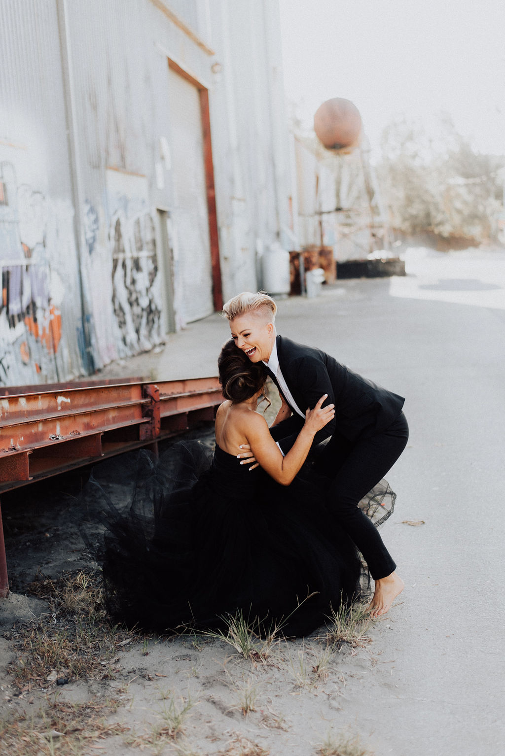 Bird and Boy Photography lesbian gay queer couple black and white tux wedding photos Gold Coast Burleigh Heads Dancing With Her wedding directory magazine